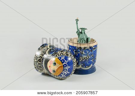 Statue of Liberty inside of Russian nesting doll. USA and Russia relations, cold war, conflict and influence conceptual background