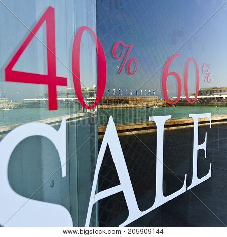 Sale Sign on Glass Window in Israel