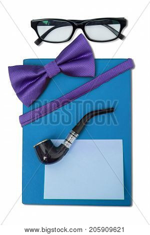 Close up of blue gift box and a blank sticky note with accessories for father isolated on white background