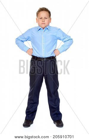 Fat boy shows his strength and seriousness. Education. Studio portrait. Isolated over white background.