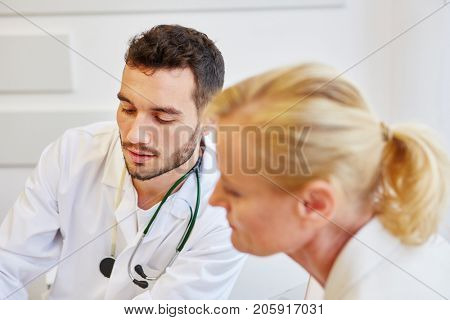 Competent doctor with patient listening in consultation and advicing about therapy