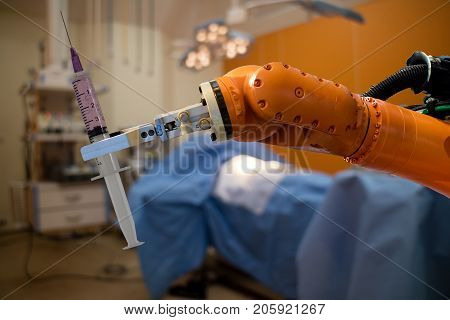 robot in medical concept robot (artificial intelligence)hold the medical syringe in the operating room for prepare to surgery the patient for faster recovery time less cosmetic damage and low costs