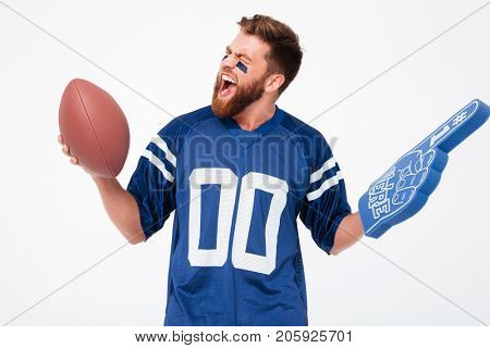 Funny agitated male fan with toys while posing isolated
