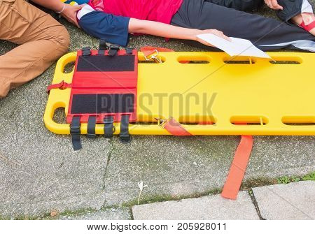 stretcher yellow and patient injured for emergency paramedic service Injury with medical equipment in emergency rescue situation
