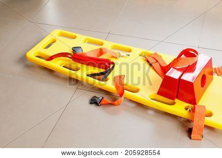 stretcher for emergency paramedic service EMS medical equipment on tile background