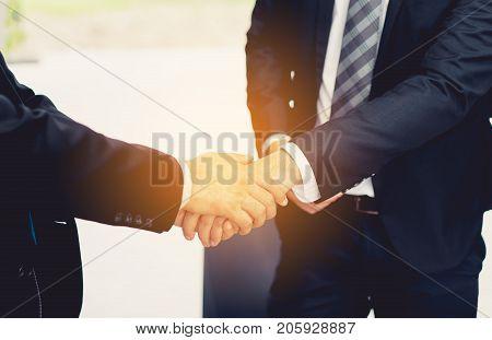 Closeup Businessmen handshake teamwork partner working success project finish complete