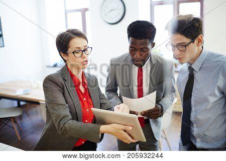 Confident woman explaining her subordinates online information or project