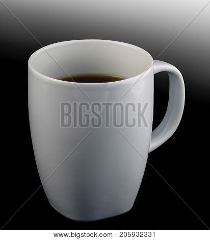 A white cup of black coffee isolated on black graded background