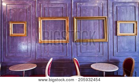 Cafe or Restaurant decorate with wooden wall and gold picture frame.