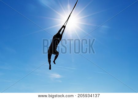 Silhouette of jumping person concept of success courage and motivation