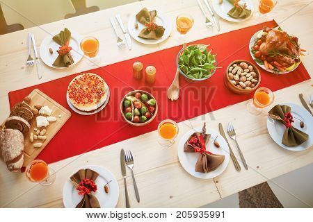 Wealthy table with plenty of festive meals served for guests