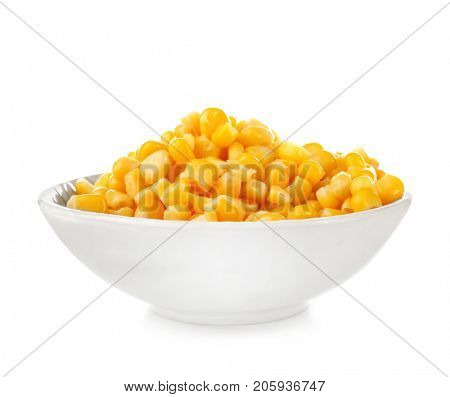 Bowl with canned corn kernels on white background