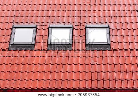 Wet Red Tiled Roof With Skylights