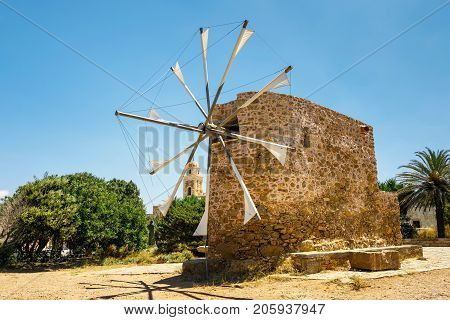 Old Stone Windmill Near The Monastery Toplou, Crete Island In Greece
