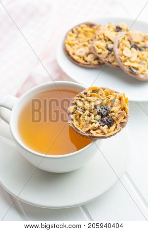 Chocolate chip cookies with nuts and raisins. Cookies with cup of tea.