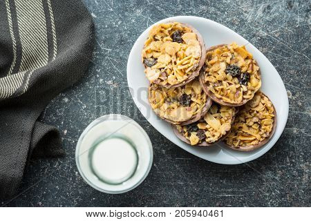 Chocolate chip cookies with nuts and raisins. Cookies and bottle of milk.