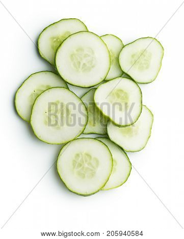 Fresh sliced cucumber isolated on white background. Top view of sliced cucumber.