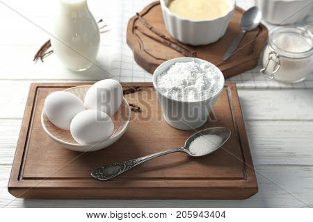 Composition with vanilla pudding and products on kitchen table