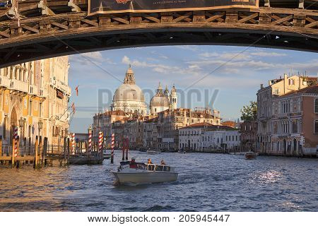 VENICE ITALY - SEPTEMBER 20 2017: View on Grant Canal with baroque church Santa Maria della Salute. It was built in the 17th century as a votive thanksgiving after the plague epidemic