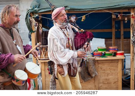 PALMANOVA ITALY - SEPTEMBER 03: Historical bagpiper and drummer dressed in ancient clothes during the historical Reenactment a.d. 1615 on September 03 2017