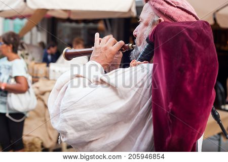 PALMANOVA ITALY - SEPTEMBER 03: Historical bagpiper dressed in ancient clothes during the historical Reenactment a.d. 1615 on September 03 2017