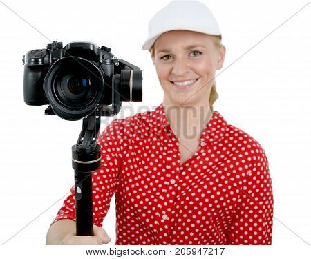 A young woman videographer using steady cam