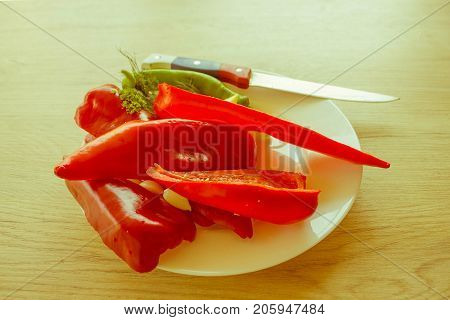 Red bell pepper backgro and Green Peppers. Fresh organic vegetables on table. Green and red bell pepper backgro. Fresh raw vegetables on the table - Retro color