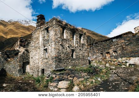 Ruined and abandoned traditional Svan towers and machub house with flagstone in Ushguli commune Upper Svaneti Georgia. Georgian landmark