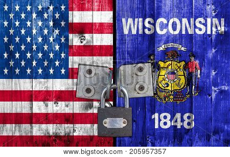 US and Wisconsin flag on door with padlock