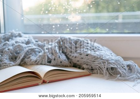 Cozy Winter Still Life: Opened Book. Warm And Comfy Autumn Or Winter Concept. Sweater. Reading Relax