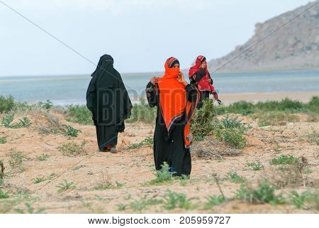 Women Dressed In The Burqa On The Countryside Of Socotra
