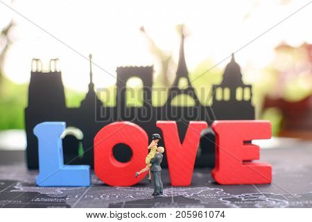 Couple in love hug each other with wooden love background using as love Valentine and togetherness concept.