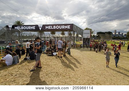 Melbourne, Australia: March 25, 2017: A large crowd of people make their way to see the Formula One event in Melbourne. The bridge enables the spectators to safely cross the race track