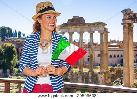 Smiling Woman In Rome With Italian Flag Looking Into Distance