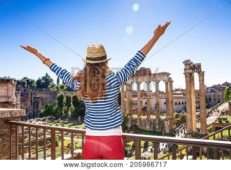 Young Tourist Woman Near Roman Forum In Rome, Italy Rejoicing