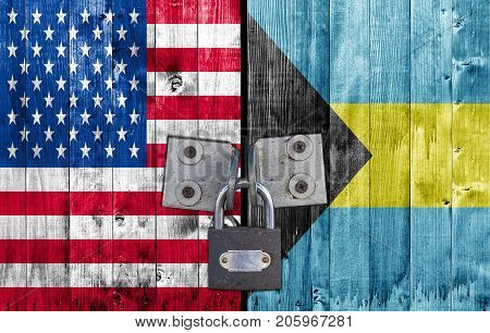 US and Bahamas flag on door with padlock