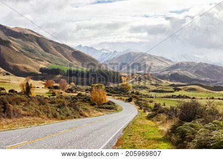 Scenic Road along Lake Hawea at  autumn day, South Island, New Zealand.