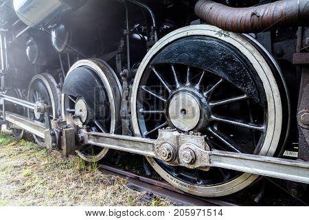 A steam locomotive wheels in black color.