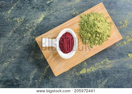 Maqui berry and hemp protein powders on color background