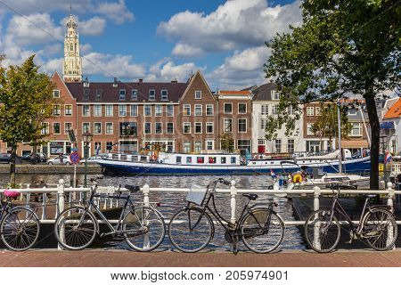 HAARLEM, NETHERLANDS - SEPTEMBER 03, 2017: Bicycles and blue ship at the canals of Haarlem Netherlands