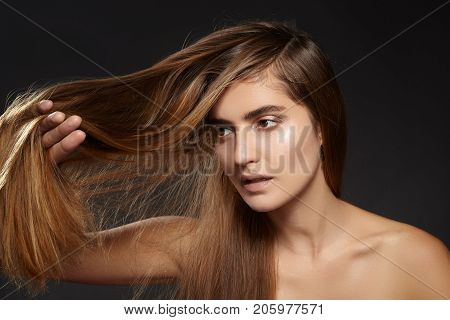 Beautiful fashion woman with long brown hair. Beauty treatment. Straight Hairstyle. Hair problem. Collagen repair keratin