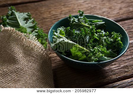 Close-up of mustard greens on wooden table