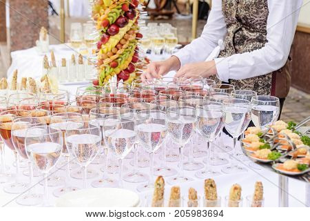 Outdoor Beautifully Decorated Catering Banquet Table With Different Food Snacks And Appetizers On Co
