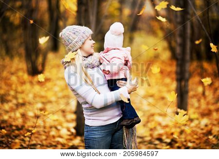 happy mother and baby outdoor in the autumn park