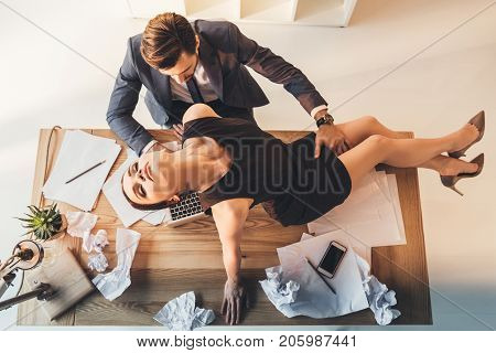 Seductive Woman Sitting On Office Desk