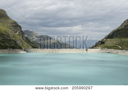 Artificial lake and weir of lac de Moiry in Switzerland