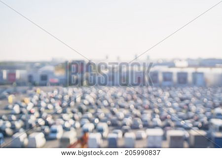Panoramic view of Full car park next to shopping center outside. Cars on large parking lots, traffic jams and crowded outdoor parking. With place for your text, for background use.
