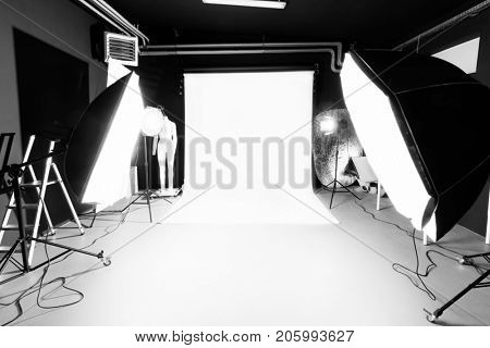 Photo studio interior with lighting equipment. Professional photography.