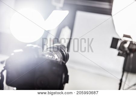 Photograpy studio with ready lighting equipment. Focus on a camera.