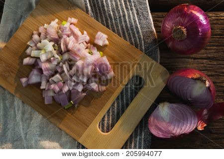 Overhead of chopped onion on chopping board
